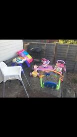 Various toddler toys. Play mat, high chair, jump and go zebra, walker, activity table,