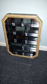 Mirror back sectional curio cabinet
