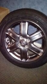 A set. Of toyota 15 inch alloy wheels