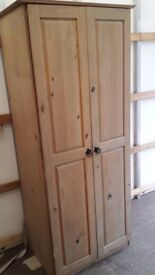 Ex-demo model. 2 door all pine wood wardrobe. Wooden robe in Mexican waxed style