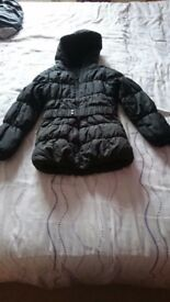 Girls black puffer winter coat. Age 7-8. Really nice & warm. Excellent condition
