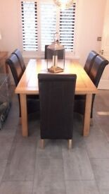 Solid Oak Dining Table & Chairs for sale.