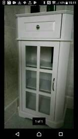 White glass fronted storage cupboard