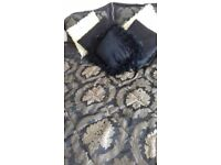 Black and gold damask quilted bed spread and curtains. Range of cushions to match included