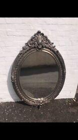 Silver framed oval mirror