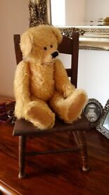 Old dolls chair and teddy