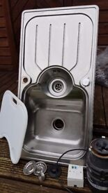 Kitchen Sink with In Sink Erator and Fitted Chopping Board