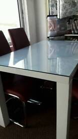 White Gloss table and 4 red chairs like new