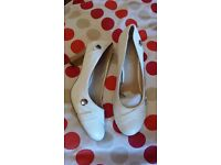 Two pairs of shoes. One white one red size 7