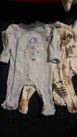 Seven baby sleepsuits from Tesco and NEXT
