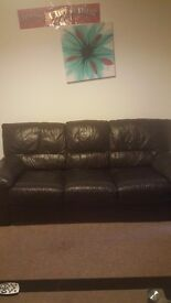 3 seater and 2 seater dark brown sofas in good condition.