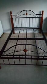 Wrought Iron bed frame with solid wooden legs