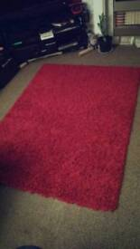 Red shaggy rug size120cm by 160cm