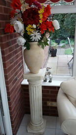 Decorative Column together with Vase and Flowers