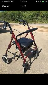Four wheel mobility walker