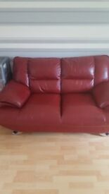 Red leather 2 seated sofa
