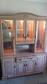 Limed oak display cabinet and matching TV unit.