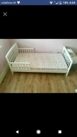 White wooden toddler bed and mattress