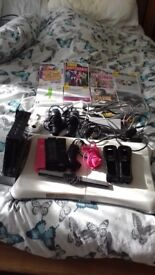 Wii bundle inc fit board & camera for your shape + games