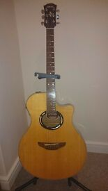 YAMAHA APX 500 electro acoustic guitar with light weight carrying case, strap & steel capo.