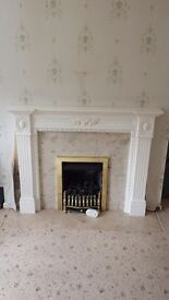 White fireplace with marble surround