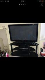 "42"" Samsung television & black glass stand"