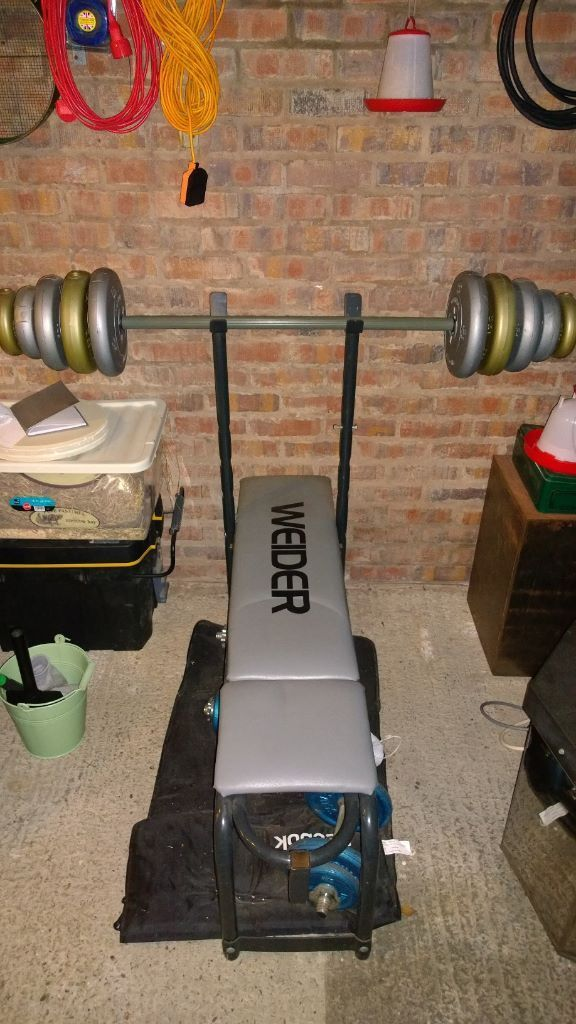 Weider Bench Press Machine With Barbell Weights And 3 Sets Of York Cast Iron D Bells Mat
