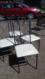 4 Dinning table chairs with Pewter metal frames & Cream material seats