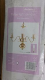 A beautiful Ceiling three lights pendent brass plated. Brand new never been used.
