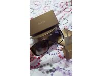 Genuine brown Gucci sunglasses. Used once or twice but in perfect condition