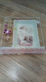 It's a girl photo frame and stand