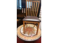 multicoloured round table and 3 chairs