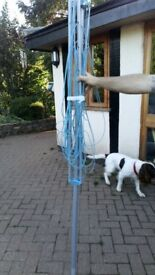 Twirley' free standing washing line that fixs in the ground.