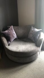 Grey 4 seater sofa and cuddle chair.