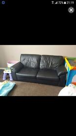Large black leather 2 seater sofa