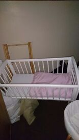 Mother are white rocking crib