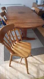 Dining table with 6 wooden chairs