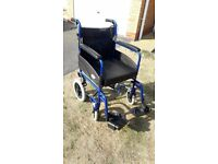 Z-Tec Folding Attendant Propelled Wheelchair with seat cushion and additional support cushion
