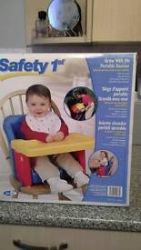 Child's portable booster seat folds away ideal for traveling