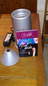 Electric wine cooler, with Oz Clarke wine guide.