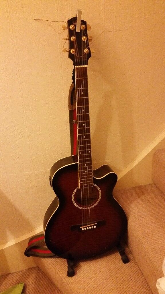 Acoustic guitar with pickup and stand
