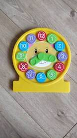 Childrens clock and shape sorter