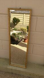 Full length/ 3 quarter length mirror with an ornate gold frame in good condition (F)