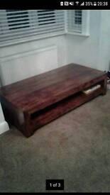 Heavy dark wooden low coffee table