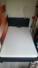Double bed with a mattress for sale