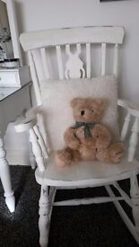 large rocking chair painted and distressed in creamy white chalk paint