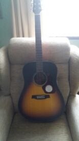 Excellent condition, barely used acoustic guitar