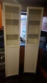 2 matching shelved display units