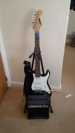 Awesome guitar and kit including amp, leads spare strings and more