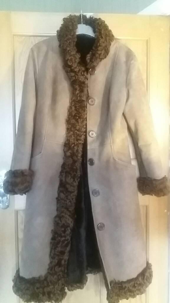 Coat sheepskin and very warm and heavy